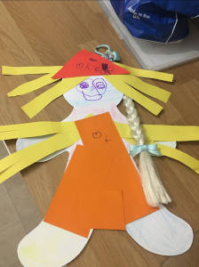 messy church - child's figure of a person made from colourful buts of paper